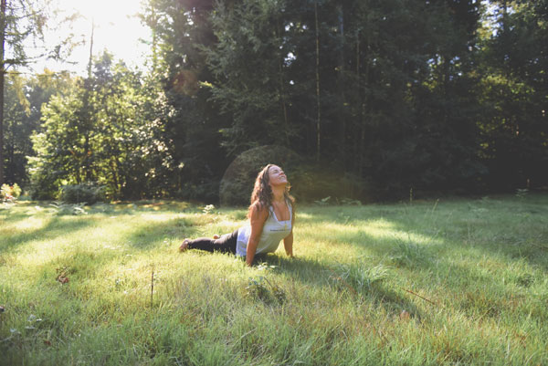 Picture of Winnie doing yoga in a park